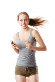 Woman doing fitness exercise and listening to her mp3 player. Isolated on white Royalty Free Stock Photo