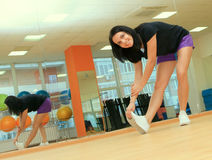 Woman doing Fitness exercise in sport center Royalty Free Stock Photo