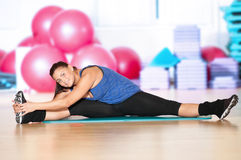 Woman doing fitness exercise at sport gym Stock Photos