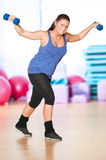 Woman doing fitness exercise at sport gym Royalty Free Stock Photography