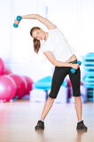 Woman doing fitness exercise at sport gym Stock Images