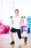 Woman doing fitness exercise at sport gym Royalty Free Stock Photos