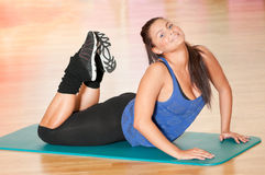 Woman doing fitness exercise at sport gym Stock Photography