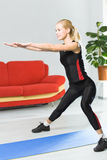 Woman doing fitness exercises. At home Royalty Free Stock Images
