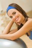 Woman doing fitness exercises Stock Photos