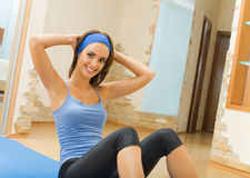 Woman doing fitness exercises Royalty Free Stock Photos