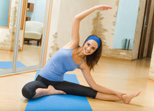 Woman doing fitness exercises. Young woman doing fitness exercises at home Stock Photo