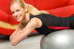 Woman doing fitness exercises Stock Photography