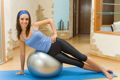 Woman doing fitness exercises. Young woman doing fitness exercises Royalty Free Stock Photos
