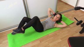Woman doing fitness exercises for abs top view close up. Stock video footage stock footage