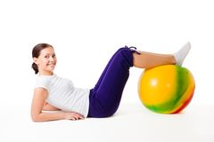 Woman doing fitness exercises with ball. Young woman doing fitness exercises with ball, isolated on white Stock Image