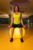 Woman doing fitness exercises with dumbbells Royalty Free Stock Photo