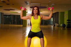 Woman doing fitness exercises with dumbbells Stock Photo