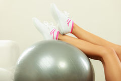 Woman doing fitness exercises with fit ball Stock Images