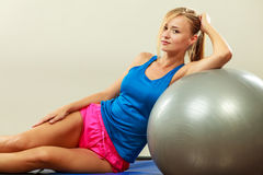 Woman doing fitness exercises with fit ball Royalty Free Stock Photography
