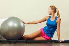 Woman doing fitness exercises with fit ball Stock Photos