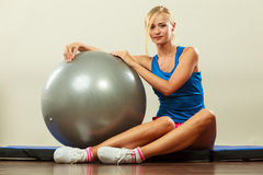 Woman doing fitness exercises with fit ball Stock Image