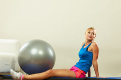 Woman doing fitness exercises with fit ball Royalty Free Stock Image