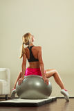Woman doing fitness exercises with fit ball Royalty Free Stock Photo