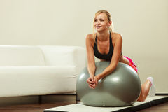 Woman doing fitness exercises with fit ball Stock Photography