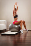 Woman doing fitness exercises with fit ball Stock Photo