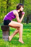 Woman doing fitness exercises outdoors. Young brunette woman doing fitness exercises outdoors stock images