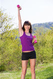 Woman doing fitness exercises outdoors. Young brunette woman doing fitness exercises outdoors Stock Photos