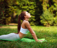 Woman doing fitness exercises in summer park, workout outdoors. Woman doing fitness exercises in a summer park, workout outdoors Stock Photography