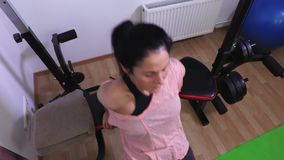 Woman doing fitness exercises for triceps top view stock video footage