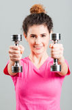 Woman doing fitness exercises using steel dumbbells Royalty Free Stock Images