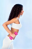 Woman doing fitness exercises. Young pretty woman doing fitness exercises, side view Royalty Free Stock Photography