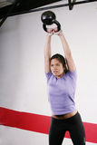 Woman doing a fitness with Kettlebell Stock Images