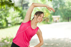 Woman doing fitness outdoors Stock Image