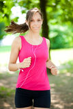 Woman doing fitness at the park Stock Photography
