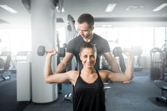 Woman doing fitness with personal trainer help. Stock Image