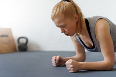 Woman doing fitness training in gym. Healthy lifestyle, slim bod Royalty Free Stock Photo