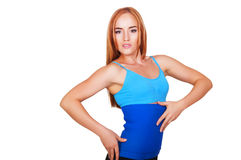 Woman doing fitness using belt for weight loss. Girl doing fitness blue belt slimming isolated on white background royalty free stock image
