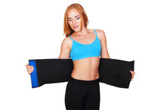 Woman doing fitness using belt for weight loss. Girl doing fitness blue belt slimming isolated on white background stock image