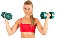 Woman doing fitness with weights Royalty Free Stock Photos