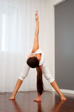 Woman doing flexibility exercise Stock Photo