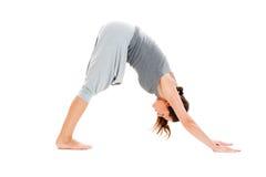 Woman doing flexibility exercise. Pretty woman doing flexibility exercise. isolated on white background Royalty Free Stock Photo