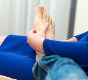 Woman doing foot massage. Stock Images