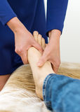 Woman doing foot massage. Stock Image