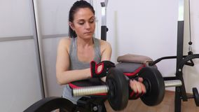 Woman doing forearm workout. At home stock video footage stock video