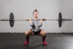Woman doing a front squat royalty free stock photos