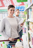 Woman doing grocery shopping Stock Images