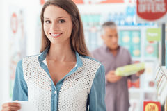 Woman doing grocery shopping stock photo