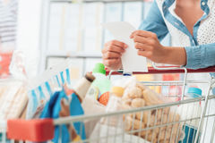 Woman doing grocery shopping Royalty Free Stock Photography
