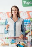 Woman doing grocery shopping stock photos