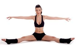 Woman doing gymnastic exercise on floor Royalty Free Stock Images